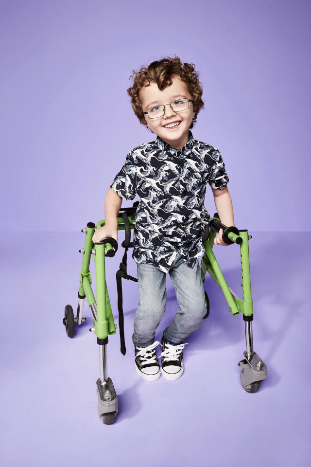 Teddy, who has cerebal palsy, makes an amazing model. (Photo: River Island)