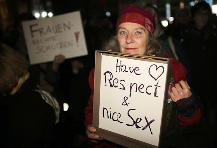 A woman holds a sign during a demonstration in the German city of Cologne on January 5, 2016 (AFP Photo/Oliver Berg)