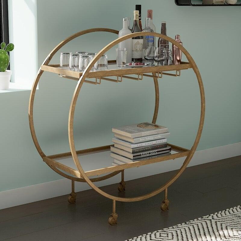 <p>This fun-shaped <span>Karon Bar Cart</span> ($350, originally $490) will add character to your living room.</p>