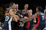 France players celebrate on the court at the end of a women's basketball quarterfinal round game against Spain at the 2020 Summer Olympics, Wednesday, Aug. 4, 2021, in Saitama, Japan. (AP Photo/Eric Gay)