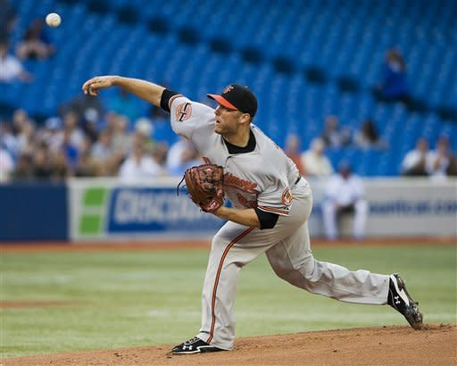 Baltimore Orioles pitcher Tommy Hunter pitches against the Toronto Blue Jays in the first inning the during a baseball game in Toronto Monday May 28, 2012. (AP Photo/The Canadian Press, Aaron Vincent Elkaim)