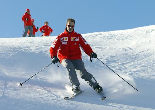 In this file picture taken on 11 January, 2005, German Formula 1 driver Michael Schumacher skis in the winter resort of Madonna di Campiglio, in the Dolomites area, Northern Italy. AFP PHOTO / Press Ferrari (AFP Photo/STR)