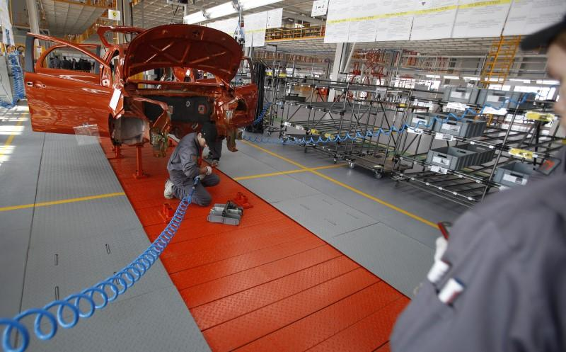 FILE PHOTO: Mechanics work on an assembly line in the car factory of Great Wall Motor Co near the town of Lovech