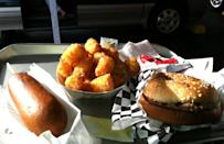 """<p>The Moonlight Drive-In's name is no coincidence; it's close to one of <a href=""""https://www.thedailymeal.com/things-to-do-florida-that-arent-disney?referrer=yahoo&category=beauty_food&include_utm=1&utm_medium=referral&utm_source=yahoo&utm_campaign=feed"""" rel=""""nofollow noopener"""" target=""""_blank"""" data-ylk=""""slk:Florida's top attractions"""" class=""""link rapid-noclick-resp"""">Florida's top attractions</a>, Kennedy Space Center, and tourists flock to this old-school restaurant for a budget-friendly meal delivered by carhops after a day exploring the headquarters. As for the food, you'll find diner classics like burgers, chicken tenders and hot dogs. Save room for dessert — there's a chocolate peanut butter milkshake.</p>"""