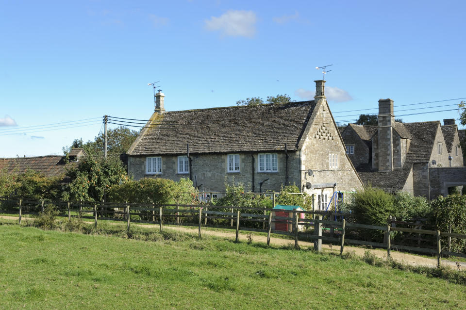 The manor grounds include cottages. (Savills)