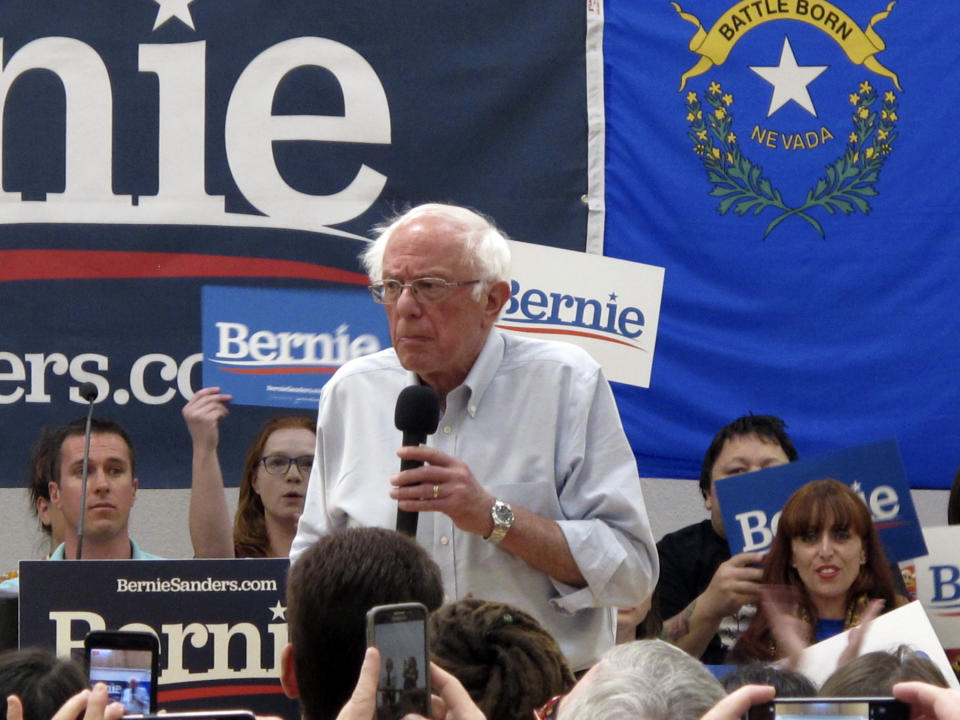 """Sen. Bernie Sanders, I-Vt., speaks to several hundred people while campaigning for president at a town hall meeting at the Carson City Convention Center, Friday, Sept. 13, 2019, in Carson City, Nev. He said former Vice President Joe Biden is distorting Sanders' """"Medicare for All"""" health care plan. (AP Photo/Scott Sonner)"""