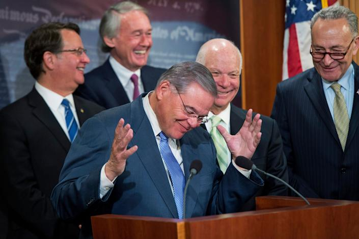 From left, Sens. Gary Peters (D-Mich.), Ed Markey (D-Mass.), Bob Menendez (D-N.J.), Ben Cardin (D-Md.) and Charles Schumer (D-N.Y.) conduct a news conference on April 20, 2016, in the Capitol to discuss the federal government's role in strengthening drinking water infrastructure. They are reacting to Schumer's decision to not make remarks.