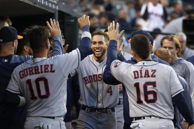 Houston Astros' George Springer (4) celebrates his inside-the-park home run during the fifth inning of the team's baseball game against the Detroit Tigers in Detroit, Tuesday, May 14, 2019. (AP Photo/Paul Sancya)