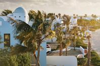 """<p><b>Maundays Bay, Anguilla</b></p> <p>It was spectacular before the storm: a strand of stark-white villas with Greco-Moorish domes and archways keeping chic company with the aquamarine shimmer of Maundays Bay. But when the eyewall of Hurricane Irma savaged and swamped Anguilla in late 2017, the damage to this star-studded sanctuary forced a reboot. And what a spectacular reboot it has been. Helmed by U.S.-based designer <a href=""""https://www.rottetstudio.com/"""" rel=""""nofollow noopener"""" target=""""_blank"""" data-ylk=""""slk:Lauren Rottet's"""" class=""""link rapid-noclick-resp"""">Lauren Rottet's</a> studio and debuting late last year, <a href=""""https://www.belmond.com/hotels/caribbean/anguilla/belmond-cap-juluca/"""" rel=""""nofollow noopener"""" target=""""_blank"""" data-ylk=""""slk:Belmond Cap Juluca"""" class=""""link rapid-noclick-resp"""">Belmond Cap Juluca</a> has doubled down on exterior enchantments (including the stunning new <a href=""""https://www.belmond.com/hotels/caribbean/anguilla/belmond-cap-juluca/spa"""" rel=""""nofollow noopener"""" target=""""_blank"""" data-ylk=""""slk:Arawak Spa"""" class=""""link rapid-noclick-resp"""">Arawak Spa</a> and a sea-edge infinity pool tiled to Moorish perfection) and interior refinements in its 66 rooms and 42 suites, including bold new textiles in botanical hues and lush little courtyards reached via expansive baths. Rates start at $725; <a href=""""https://www.belmond.com/hotels/caribbean/anguilla/belmond-cap-juluca/"""" rel=""""nofollow noopener"""" target=""""_blank"""" data-ylk=""""slk:belmond.com"""" class=""""link rapid-noclick-resp"""">belmond.com</a>.</p>"""