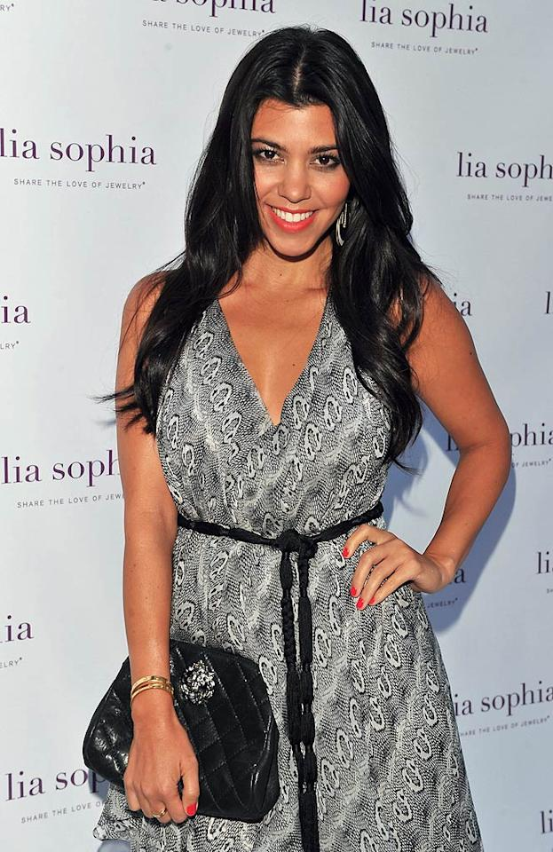 """Kourtney Kardashian looked happy to be in attendance at a party in L.A. celebrating the latest looks from the lia sophia jewelry collection. The reality gal had spent time earlier in the day posing with her family for a magazine shoot that, apparently, had to be kept under wraps. """"Amazing shoot today with my sisters for ? magazine. Oops have to keep it a secret...then off to a lia sophia jewelry event!"""" Kourtney tweeted on Tuesday. Alberto E. Rodriguez/<a href=""""http://www.gettyimages.com/"""" target=""""new"""">GettyImages.com</a> - July 26, 2011"""