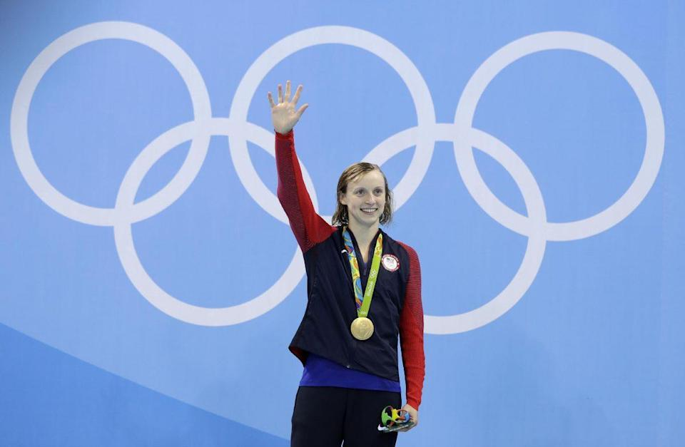 United States' gold medal winner Katie Ledecky celebrates during the medal ceremony after setting a new world record in the women's 400-meter freestyle final during the swimming competitions at the 2016 Summer Olympics, Monday, Aug. 8, 2016, in Rio de Janeiro, Brazil. (AP Photo/Michael Sohn)