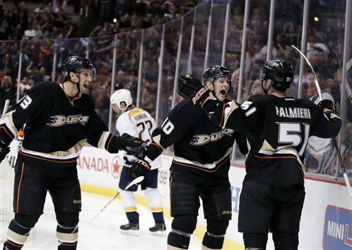 Anaheim Ducks right wing Kyle Palmieri, right, celebrates his hat trick with Nick Boninoright, left, and Corey Perry during the second period of an NHL hockey game against the Nashville Predators in Anaheim, Calif. Wednesday, Feb. 27, 2013. (AP Photo/Chris Carlson)