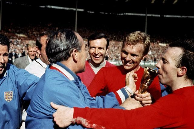Stiles, far right, kisses the Jules Rimet after England won the World Cup in 1966