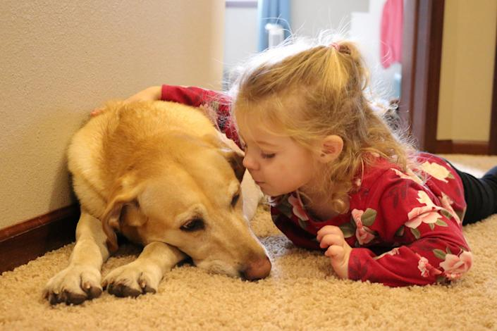 A child and her labrador.