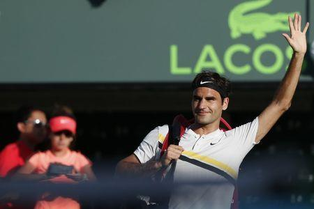 Mar 24, 2018; Key Biscayne, FL, USA; Roger Federer of Switzerland waves to the crowd while leaving the court after his match against Thanasi Kokkinakis of Australia (not pictured) on day five of the Miami Open at Tennis Center at Crandon Park. Kokkinakis won 3-6, 6-3, 7-6(4). Mandatory Credit: Geoff Burke-USA TODAY Sports