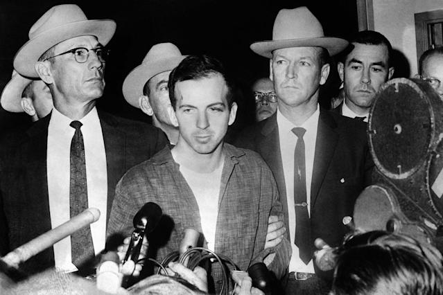 <p>President John F. Kennedy's murderer Lee Harvey Oswald during a press conference after his arrest in Dallas on Nov. 22, 2963. Lee Harvey Oswald was killed by Jack Ruby on 24 Nov. 24, 1963 on the eve of Kennedy's burial. (Photo: Stringer/AFP/Getty Images) </p>