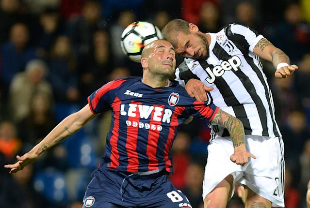 Soccer Football - Serie A - Crotone vs Juventus - Ezio Scida Municipal Stadium, Crotone, Italy - April 18, 2018 Juventus' Stefano Sturaro in action with Crotone's Bruno Martella REUTERS/Massimo Pinca