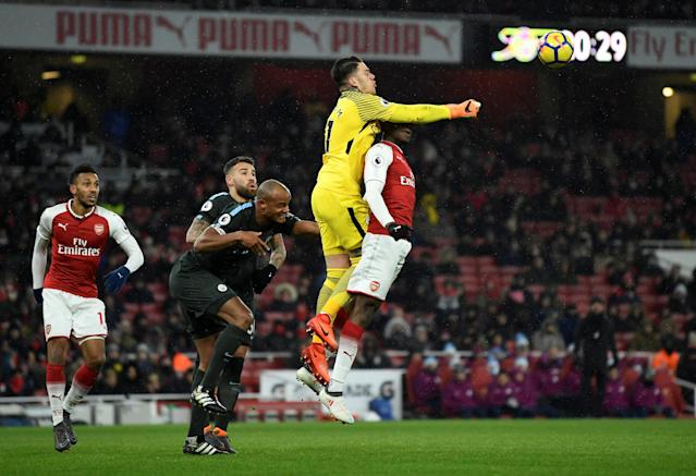 """Soccer Football - Premier League - Arsenal vs Manchester City - Emirates Stadium, London, Britain - March 1, 2018 Manchester City's Ederson, Vincent Kompany and Nicolas Otamendi in action with Arsenal's Danny Welbeck Action Images via Reuters/Tony O'Brien EDITORIAL USE ONLY. No use with unauthorized audio, video, data, fixture lists, club/league logos or """"live"""" services. Online in-match use limited to 75 images, no video emulation. No use in betting, games or single club/league/player publications. Please contact your account representative for further details. TPX IMAGES OF THE DAY"""