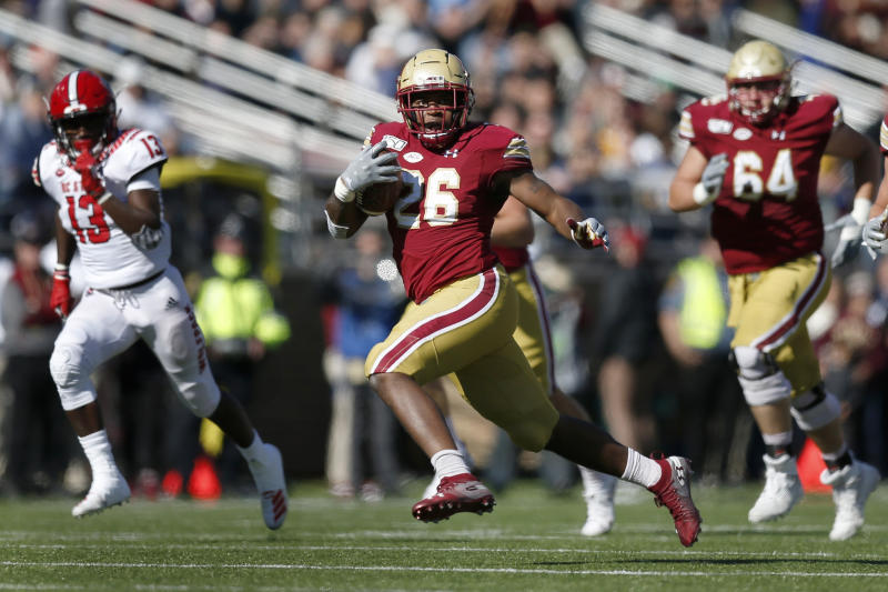 FILE - In this Oct. 19, 2019, file photo, Boston College running back David Bailey (26) carries the ball against North Carolina State during the first half of an NCAA college football game in Boston. Bailey's workload is expected to pick up in 2020, now that A.J. Dillon has left for the NFL. (AP Photo/Michael Dwyer, File)