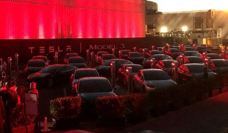 FILE PHOTO: Tesla Model 3 cars wait for their new owners as they come off the Fremont factory's production line during an event at the company's facilities in Fremont