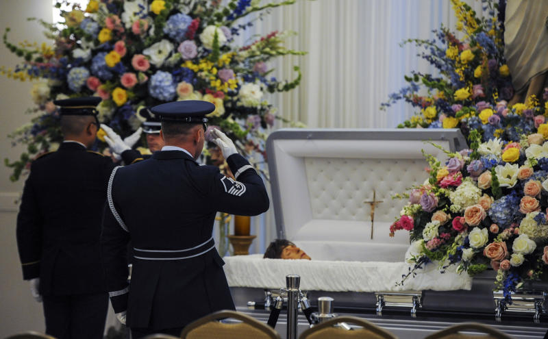 Honor guard members salute the casket of former Louisiana Gov. Kathleen Blanco during a visitation at St. John's Cathedral Hall, Friday, Aug. 23, 2019, in Lafayette, La. Blanco, who served one term as governor and various elected positions across two decades, was in Louisiana's top job during the destruction of hurricanes Katrina and Rita in 2005. She died a week earlier from cancer. (Brad Kemp/The Advocate via AP)