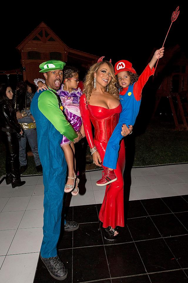 <p>Talk about friendly exes! Carey and ex-husband Nick Cannon — dressed as Luigi from Super Mario Brothers — spent the night with their cute kids, Monroe and Moroccan. (Photo: FilmMagic/FilmMagic) </p>