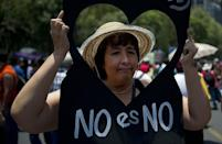 A woman joins a protest rally in Mexico City against the sexual harassment and violence against women (AFP Photo/Yuri Cortez)