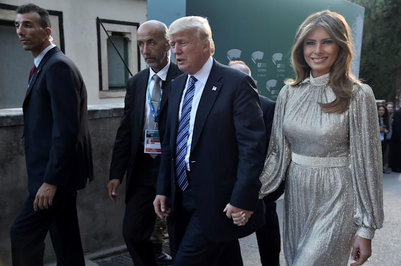 US President Donald Trump and first lady Melania Trump arrive for a concert of La Scala Philharmonic Orchestra at the ancient Greek Theatre of Taormina during the Heads of State and of Government G7 summit, on May 26 in Sicily.