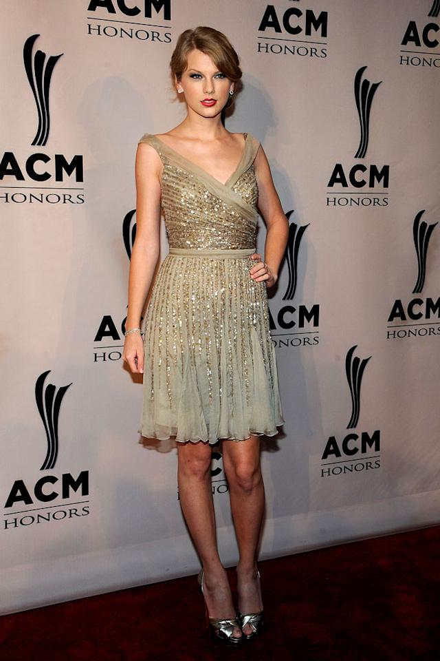 """A mature-looking Taylor Swift rocked the red carpet at the 5th Annual ACM Honors in an embellished Elie Saab stunner. The country songstress accessorized with matching sandals, monstrous diamond earrings, and a chic chignon. Frederick Breedon IV/<a href=""""http://www.gettyimages.com/"""" target=""""new"""">GettyImages.com</a> - September 19, 2011"""