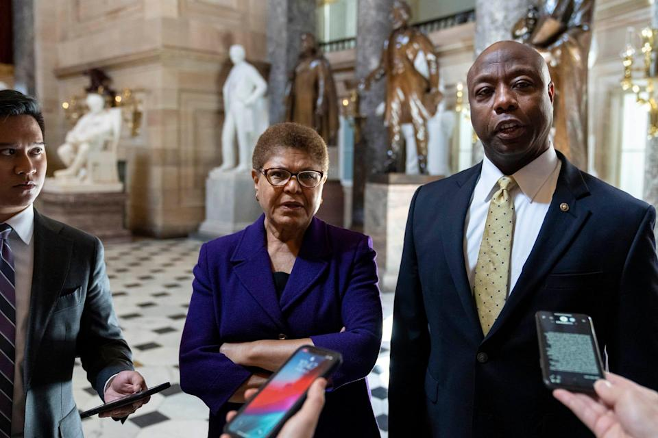 WASHINGTON, DC - MAY 18: (L-R) Rep. Karen Bass (D-CA) and Sen. Tim Scott (R-SC) speak briefly to reporters as they exit the office of Rep. James Clyburn (D-SC) following a meeting about police reform legislation on Capitol Hill May 18, 2021 in Washington, DC. President Joe Biden has called for Congress to pass a police reform bill by the May 25th anniversary of the killing of George Floyd by  Minneapolis Police officer Derek Chauvin. Lawmakers are still discussing key provisions in the bill, including qualified immunity laws for law enforcement officers. (Photo by Drew Angerer/Getty Images)