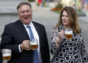 U.S. Secretary of State Mike Pompeo, left, and his wife Susan Pompeo hold a glass of beer during a visit at a brewery in Pilsen near Prague, Czech Republic, Tuesday, Aug. 11, 2020. U.S. Secretary of State Mike Pompeo is in Czech Republic at the start of a four-nation tour of Europe. Slovenia, Austria and Poland are the other stations of the trip. (AP Photo/Petr David Josek, Pool)