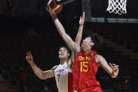 Canada's Dwight Powell battles with China's Qi Zhou during the first half of a FIBA men's Olympic basketball qualifying game Wednesday, June 30, 2021, in Victoria, British Columbia. (Chad Hipolito/The Canadian Press via AP)