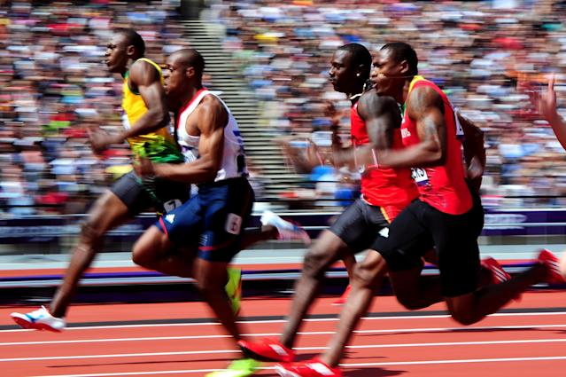 LONDON, ENGLAND - AUGUST 04: (L-R) Usain Bolt of Jamaica and James Dasaolu of Great Britain compete in the Men's 100m Round 1 Heats on Day 8 of the London 2012 Olympic Games at Olympic Stadium on August 4, 2012 in London, England. (Photo by Stu Forster/Getty Images)