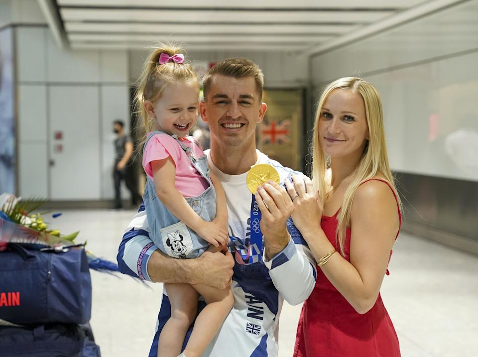 Olympic gymnast Max Whitlock, with his wife Leah and daughter Willow, as he arrives back at London Heathrow Airport from the Tokyo 2020 Olympic Games. Picture date: Tuesday August 3, 2021.