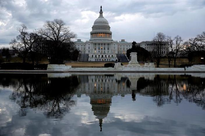 FILE PHOTO: Clouds pass over the U.S. Capitol at the start of the third day of a shut down of the federal government in Washington