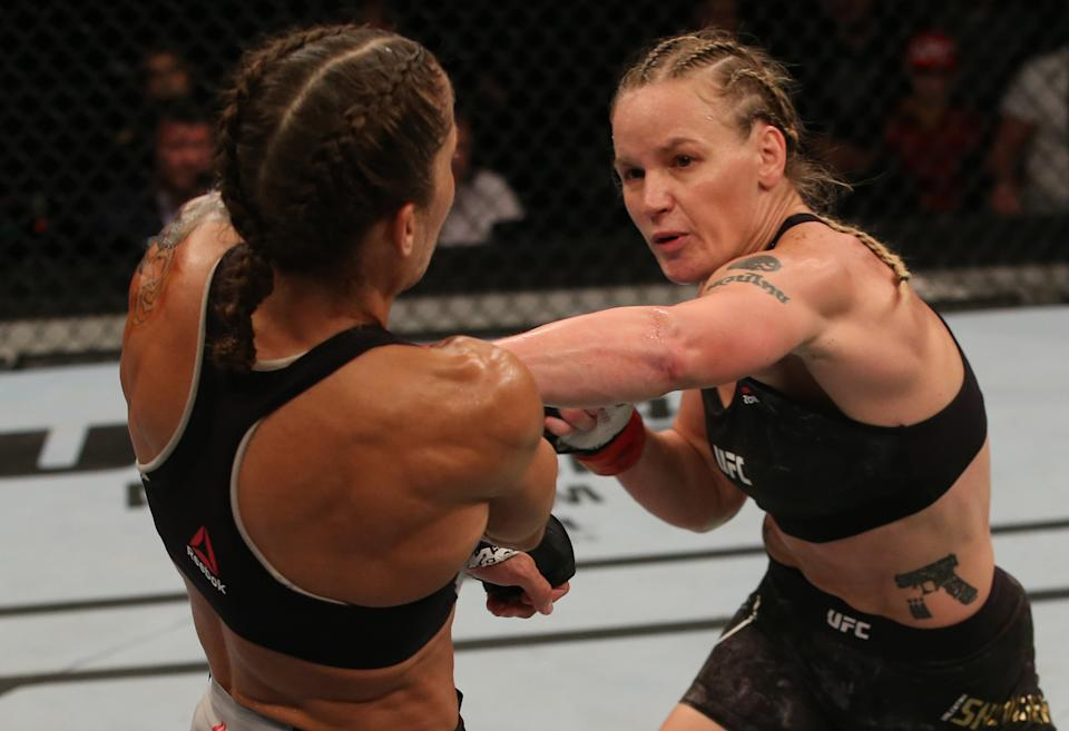 MONTEVIDEO, URUGUAY - AUGUST 10:  (R-L) Valentina Shevchenko of Kyrgyzstan punches Liz Carmouche in their UFC women's flyweight championship fight during the UFC Fight Night event at Antel Arena on August 10, 2019 in Montevideo, Uruguay. (Photo by Alexandre Schneider /Zuffa LLC/Zuffa LLC)