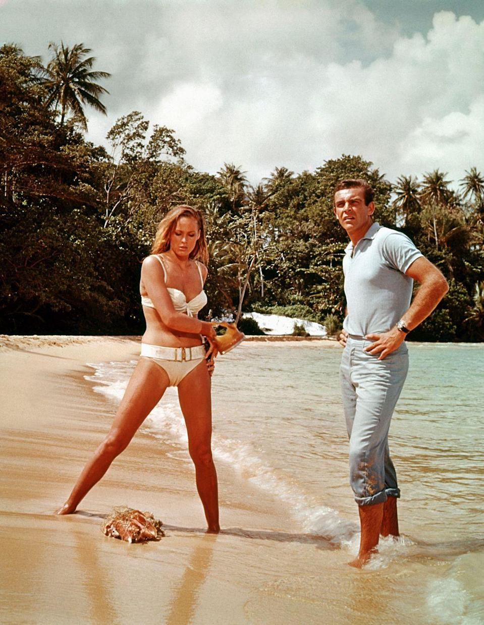 <p>Ursula Andress and Sean Connery on the shore in a scene from Dr. No.</p>