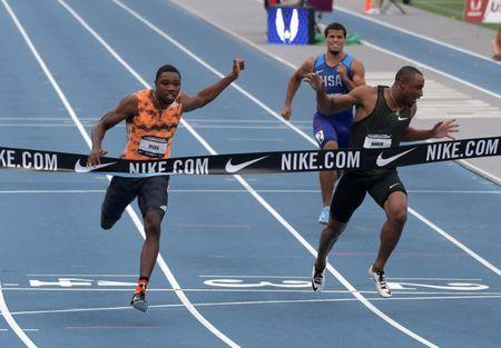 Jun 22, 2018; Des Moines, IA, USA; Noah Lyles left) defeats Ronnie Baker (center) to win the 100m, 9.88 to 9.90, during the USA Championships at Drake Stadium. Bryce Robinson (right) was seventh in 10.55. Mandatory Credit: Kirby Lee-USA TODAY Sports