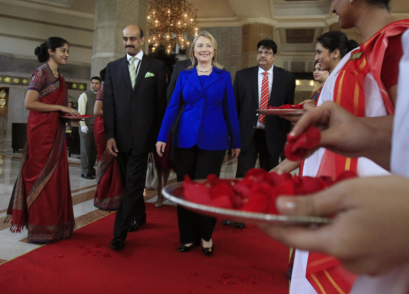 U.S. Secretary of State Hillary Rodham Clinton leaves the Taj Hotel in Kolkata Monday, May 7, 2012. Clinton urged energy-starved India on Monday to reduce its Iranian oil imports to keep up pressure on the Islamic republic to come clean about its nuclear program. (AP Photo/Shannon Stapleton, Pool)
