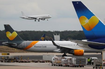 Airplanes with the logos of air carrier Condor by Thomas Cook are seen at the airport  in Frankfurt