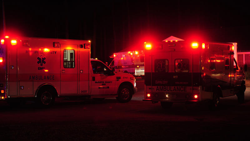 Ambulances gather at the old Georgia State Patrol post in Thomson, Ga., near the scene of a plane crash Wednesday, Feb. 20, 2012. An aviation official says a small jet with seven people aboard ran off the end of the runway and crashed at the Thomson-McDuffie County Airport.  (AP Photo/The Augusta Chronicle, Todd Bennett)