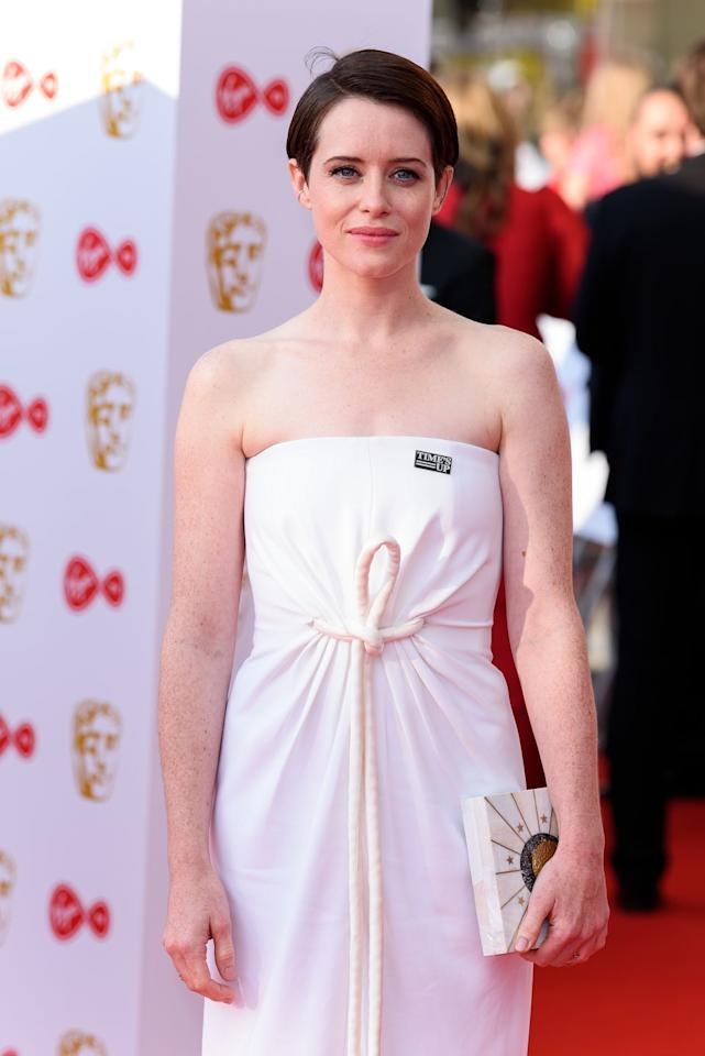"<p><a rel=""nofollow"" href=""https://www.goodhousekeeping.com/beauty/hair/tips/g409/celebrity-hairstyles-pixie/"">Pixie cuts</a> are surprisingly versatile. In this case, Clare Foy is wearing hers deeply parted and slicked all to one side for a more formal look. Try a gel like <strong>Redken Short Sculpt 19</strong> to keep your hair in place without stiffness.</p><p><a rel=""nofollow"" href=""https://www.amazon.com/Redken-Short-Sculpt-Touchable-Texturizing/dp/B00WAEMQ42"">SHOP GELS</a></p>"