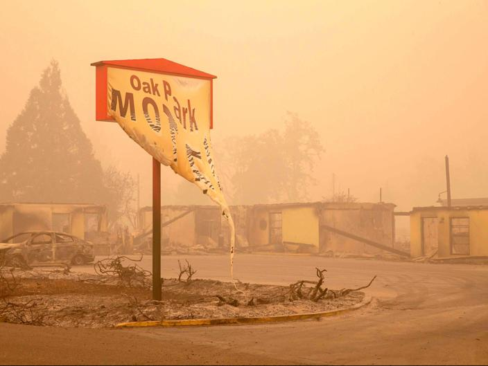 The melted sign of the Oak Park Motel destroyed by the flames of the Beachie Creek Fire is seen in Gates, east of Salem, Oregon (POOL/AFP via Getty Images)