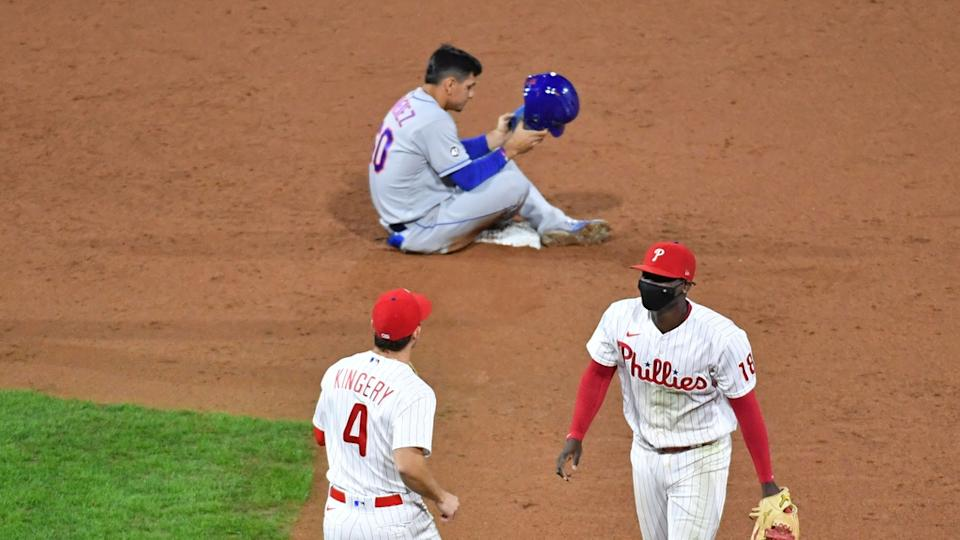 Andres Gimenez sitting on the ground after Phillies turn double play