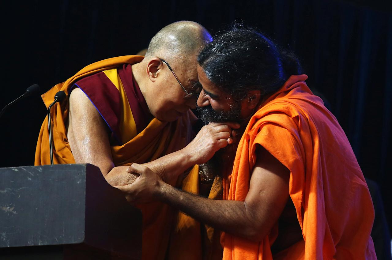 <p>Tibetan spiritual leader the Dalai Lama and Yoga Guru Baba Ramdev share a moment during the World Peace and Harmony conclave ahead of India's Independence Day in Mumbai, India August 13, 2017. REUTERS/Shailesh Andrade </p>