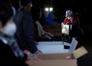 An elderly man receives food aid handouts, as the spread of the coronavirus disease (COVID-19) continues in Tokyo