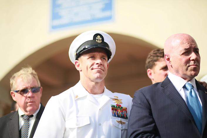 SAN DIEGO, CA - JULY 02:R, Navy Special Operations Chief Edward Gallagher celebrates after being acquitted of premeditated murder at Naval Base San Diego July 2, 2019 in San Diego, California. Gallagher was found not guilty in the killing of a wounded Islamic State captive in Iraq in 2017. He was cleared of all charges but one of posing for photos with the dead body of the captive. (Photo by Sandy Huffaker/Getty Images): Getty Images
