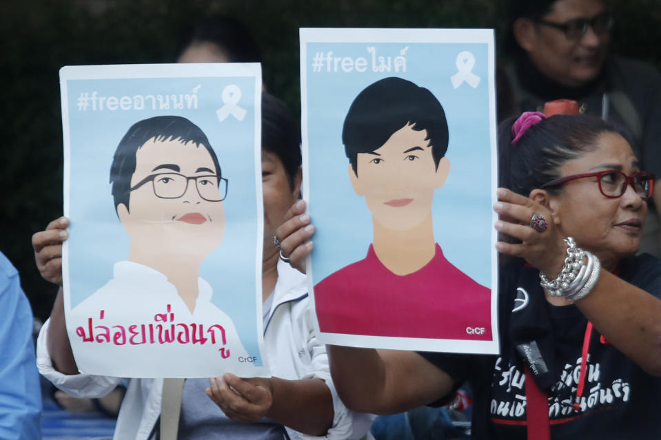 Pro-democracy activists display images of protest leaders that are kept in detention during a protest outside remand prison, in which some of the activists are kept, in Bangkok, Thailand, Friday, Oct. 23, 2020. Thailand's government on Thursday canceled a state of emergency it had declared last week for Bangkok in a gesture offered by the embattled prime minister to cool student-led protests seeking democracy reforms. (AP Photo/Sakchai Lalit)