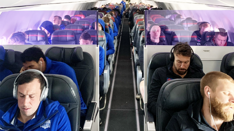 North Melbourne and Essendon players, pictured here sharing a flight to Sydney.