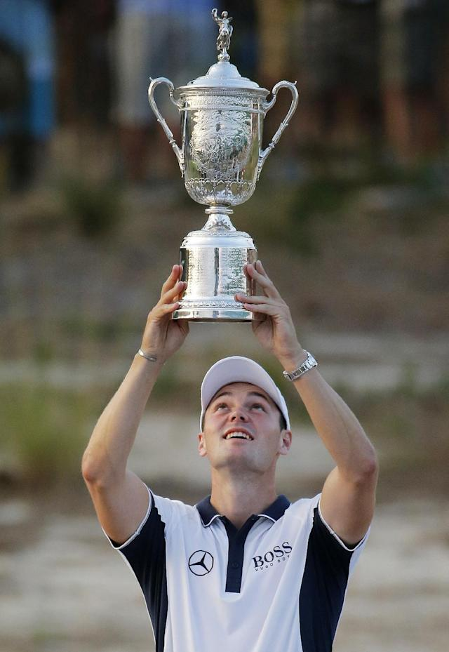 Martin Kaymer, of Germany, holds up the trophy after wining the U.S. Open golf tournament in Pinehurst, N.C., Sunday, June 15, 2014. (AP Photo/Matt York)
